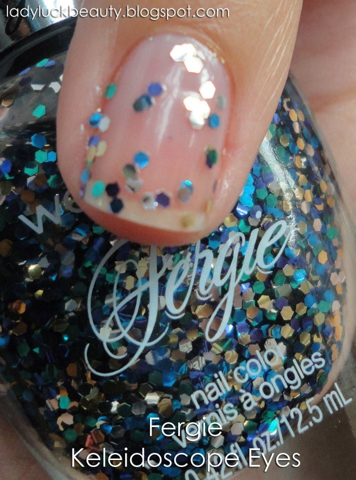 Fergie Wet n Wild Fergie Kaleidoscope Eyes, swatched on nail wheel. Turquoise & gold glitter in a clear base, $3