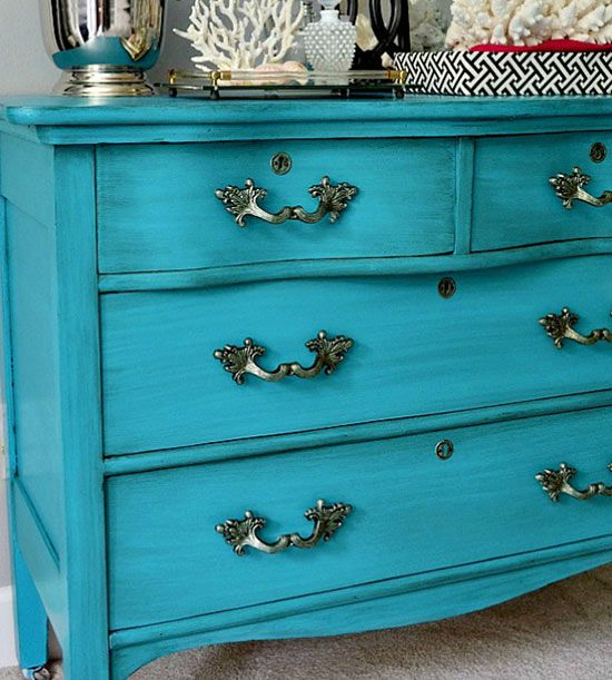 Ocean Inspired: Use an oil-base primer, acrylic paint, antiquing glaze and polyurethane to give a coastal vibe to the dresser. The depth you see was created by layering a dark glaze atop bright turquoise paint. Spray-painted hardware.