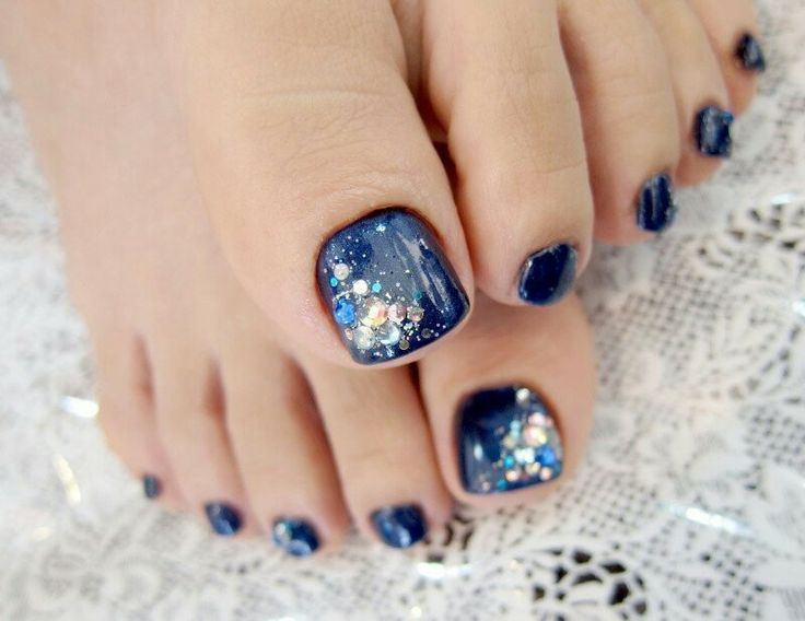 Navy & Large Glitter Pedicure!  Come to Beauty Bar & Browz in Ferndale, MI for all of your grooming and pampering needs!  Call (313) 433-6080 to schedule an appointment or visit our website www.beautybarandbrowz.com to learn more about us!