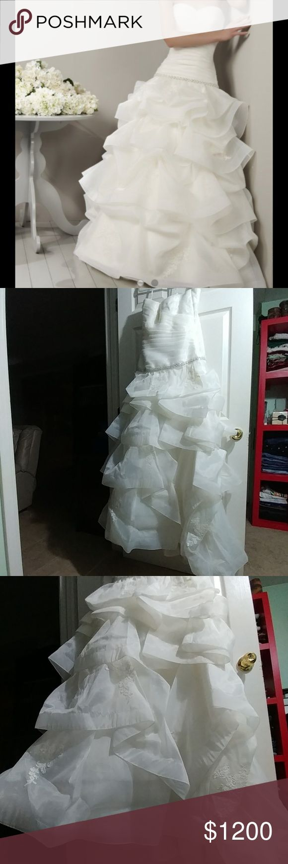 🎉FINAL🎉 Adriana Alier Bridal Wedding Gown, NWT New with tags.   This beautiful wedding gown is size 12 but can tighten from the back and perhaps fit someone a bit smaller as well.   Please don't hesitate to ask any questions. Reasonable offers considered. Adriana Alier Dresses Wedding