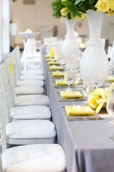 Weddings - white vases, grey table cloth & with yellow accents
