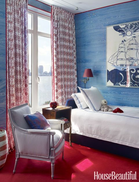"""We wanted a bright, cheery room that said little boy,"" designer Miles Redd says of a kid's room in a New York City apartment. He paired the existing carpet with hand-painted faux-bois walls by Hurtado. ""The red outline lends graphic edge."""