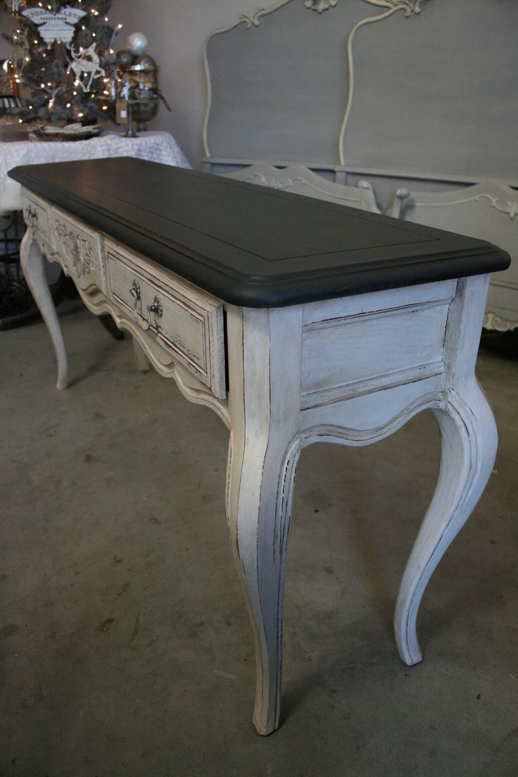 This long, narrow console table came from an estate sale I attended recently.          The curving lines of the table give it a Fre...