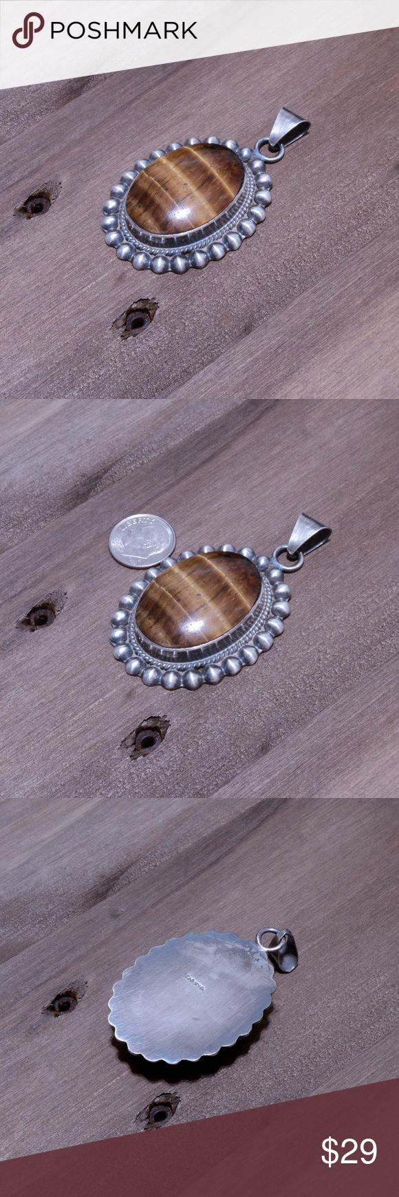 "‼️Clearance‼️Large Vintage 925 & Tigers Eye Pendan Stamped ""mexico925"". Pendant Hangs: 65 mm. Weighs 32.4 grams. The image is of the actual article that is being sold. Sterling silver is an alloy of silver containing 92.5% by mass of silver and 7.5% by mass of other metal. The fitness on this ring is 950. All my jewelry is solid sterling silver. I do not plate. crafted in Taxco, Mexico. Jewelry Necklaces"