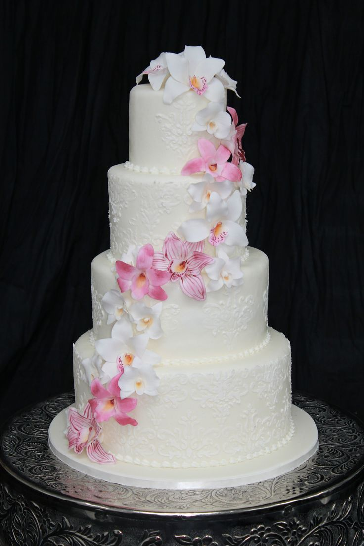 Wedding cake with Damask stencil design and Pink Sugar Orchids