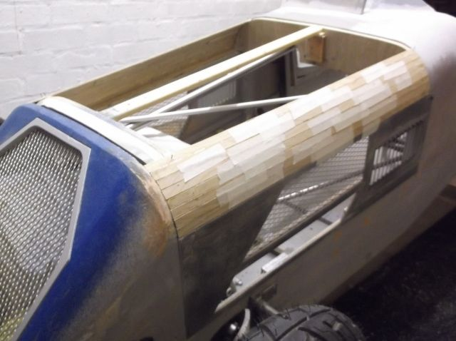Plywood strips being used to make the bonnet/hood.