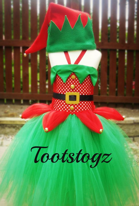 Ideal for either Xmas or Halloween costume.    This is made with plenty of green & red tulle.    This costume includes the elf hat with a jingle bell
