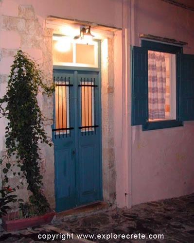 blue front door with barred window.