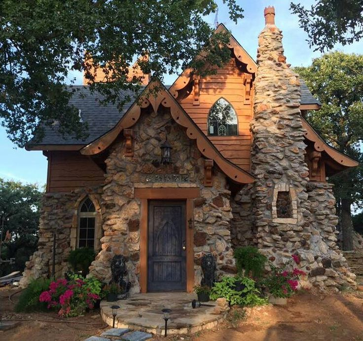 "I am quite certain this is the ""Gwendolyn"" plan from Storybookhomes.com To see it built is nice. It looks like it could be in Disneyworld. Love the stone work"