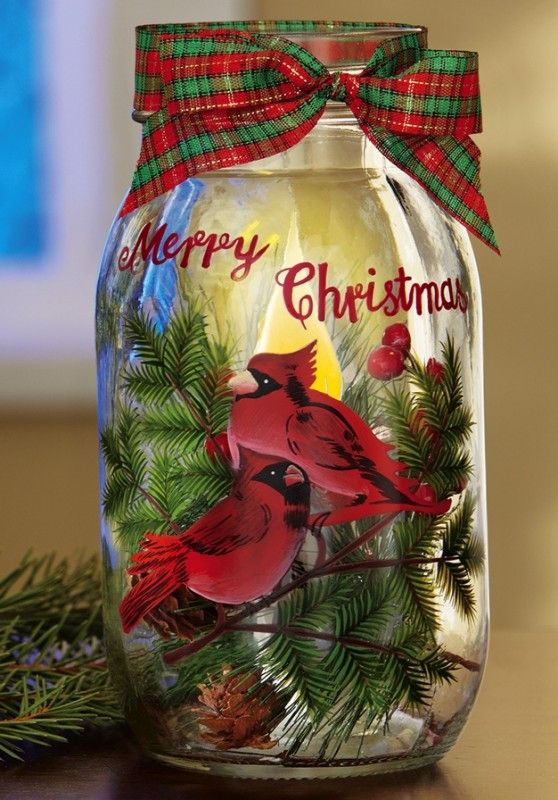Cardinal Mason Jar Flickering Candle Night Light - Old-fashioned, jar style candleholder holds an LED candle that flickers like the real thing for a reassuring glow at night. It features a hand-painted Cardinal, faux greenery, berries and real pinecones inside. Includes 3 button cell batteries.   Link    #Christmas