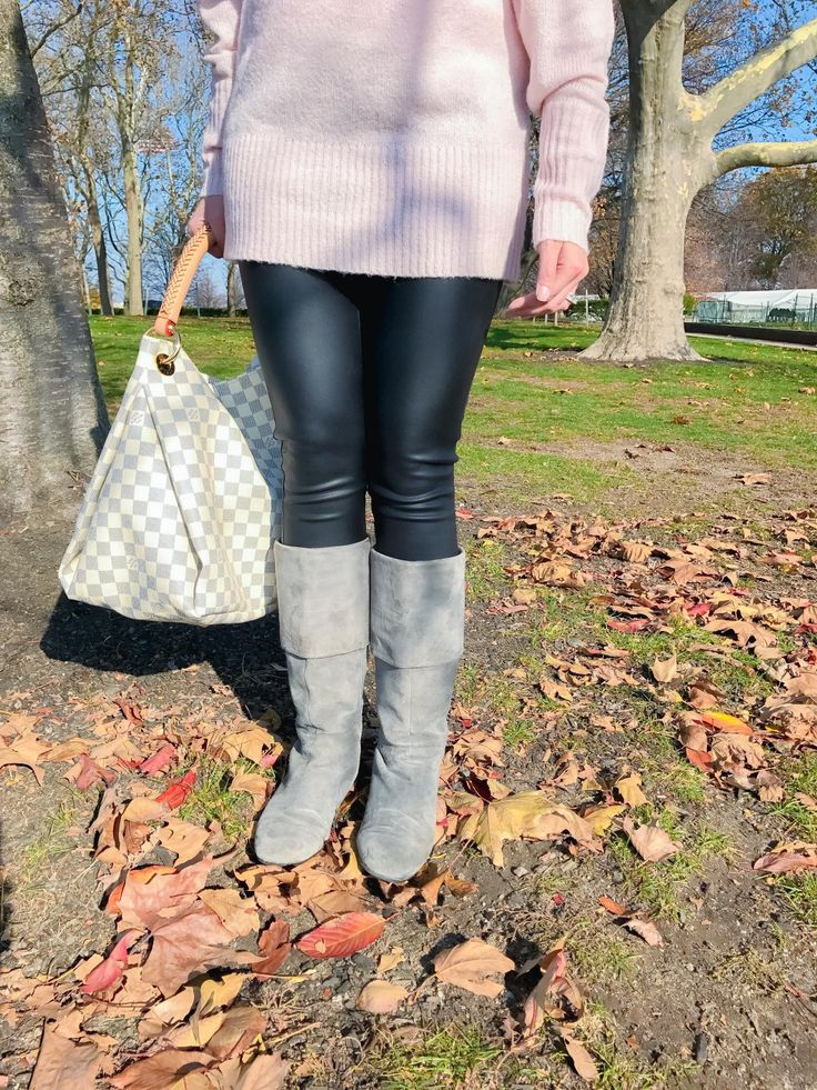 woman in Liberty Island, New York wearing blush Express off the shoulder top sweater, black faux leather leggings, gray suede rockport boots, tiffany & co. sunglasses, and louis vuitton artsy in damier azur - fall fashion outfits, fall style for women; Easy everyday outfits for women