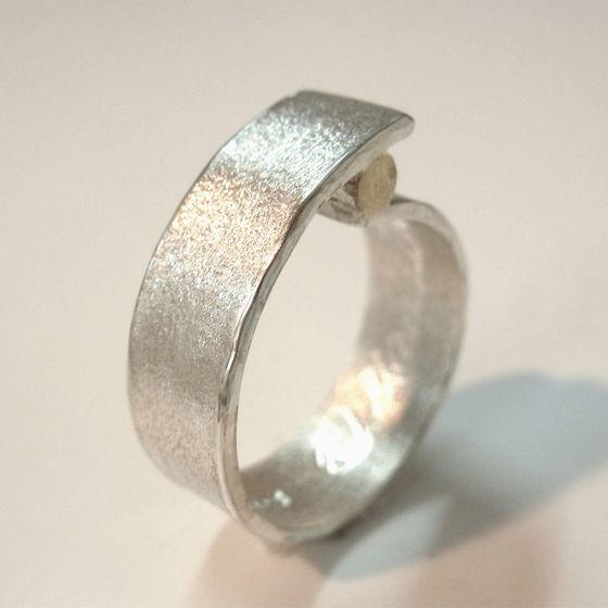 Koru insirped sterling silver and brass ring by ntm. jewellery