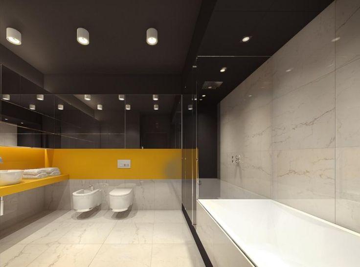 Bagno molto spazioso nella schema di colori bianco e nero con un'aggiunta di giallo