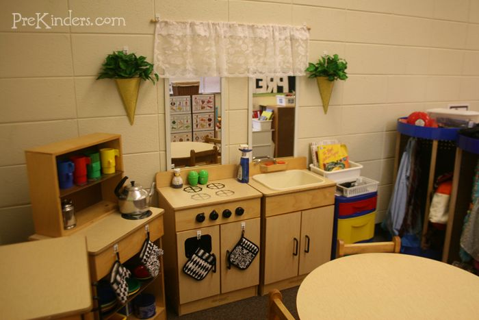 What a cute housekeeping center.  I wish I wasn't such a broke teacher so I could go out and copy this one.