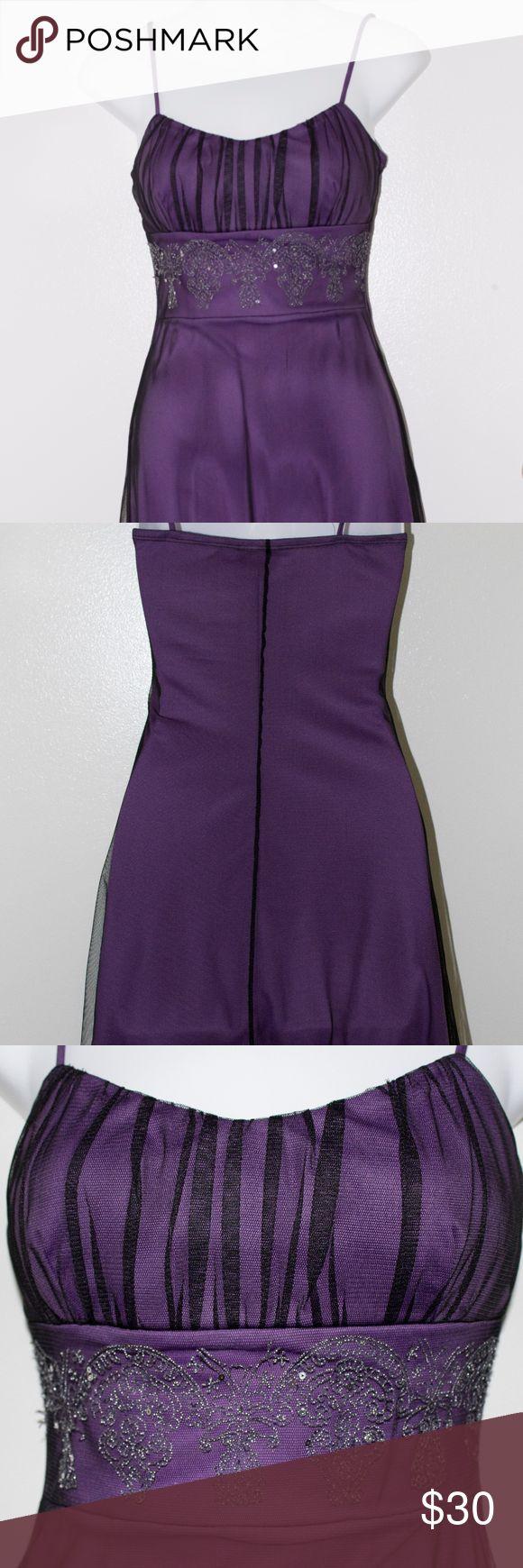 Taboo purple mini dress size small This is a beautiful purple dress with a beaded lace pattern on top of tool. It has spaghetti straps and it has horizontal black lines at the top. Taboo Dresses Mini