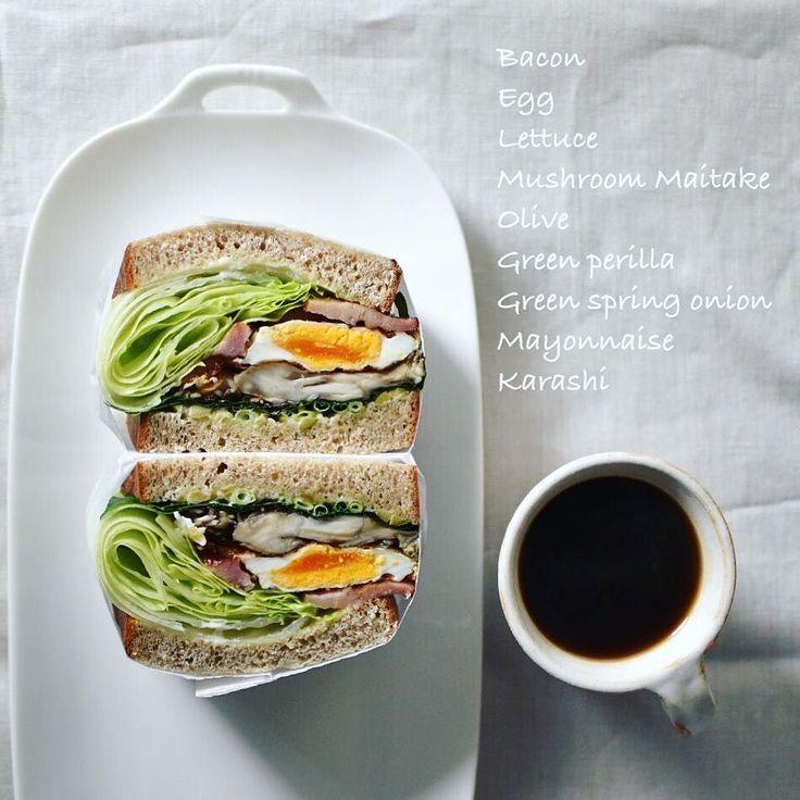 Today's BLEM sandwiches! BLEM サンドでこんにちは なんのこっちゃガッツリ具沢山サンド なかなか舞茸いい感じ この夏は紫蘇をサンドするのにハマってます ベーコン レタス 目玉焼き 舞茸 シソ 万能ねぎ オリーブ 全粒粉パン