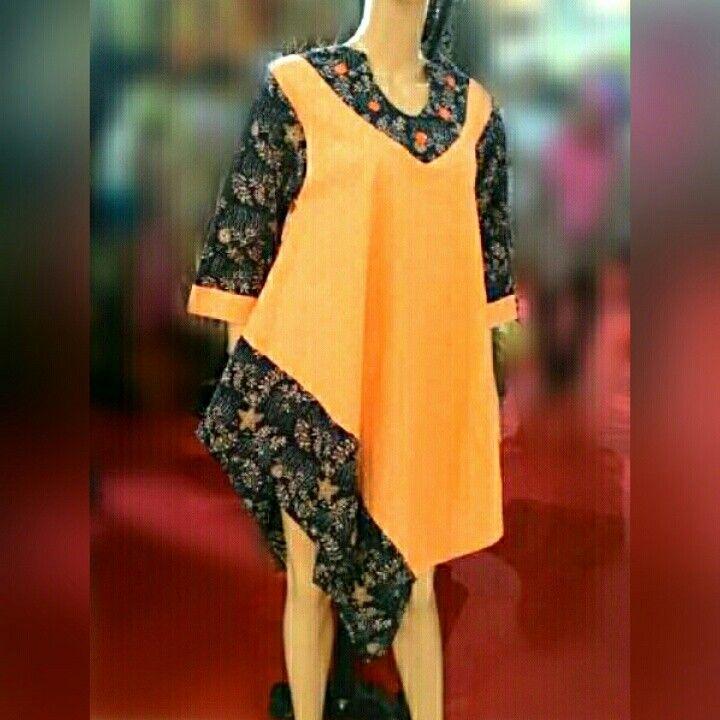 Tunik Asimetris   Tunik/Dress model asimetris yg trendy dan lembut melambai seiring langkah Anda. Terbuat dari kain batik kombinasi dengan batik emboss... Bisa dipadukan dengan celana atau legging.  Simple asimetris and flowy tunik/dress. Made from batik combined with batik emboss.   Order please Contact: SMS /WA +6282281115732, BBM 5B54D9C1 & DOS03885, Path Aalina Batik, Line Aalina Batik, IG @aalinabatik, FB Aalina Batik.