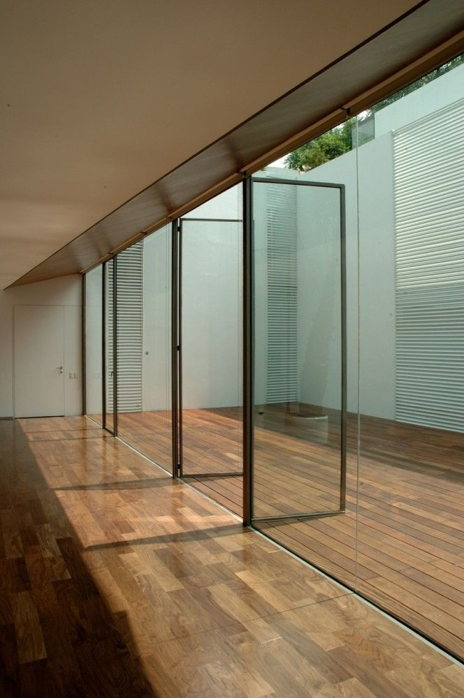 Gallery of cb30 dellekamp arquitectos 4 architects for The interior architectural design company cardiff