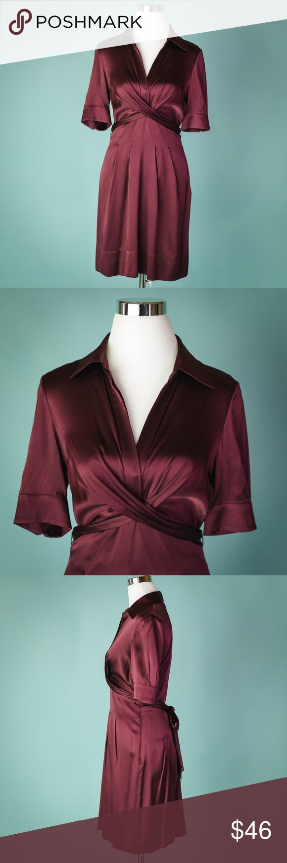BCBG Max Azria Size 6 Burgundy Silk Dress BCBG Max Azria Size 6 Burgundy Silk Short Sleeve Cross Front Dress  Size 6 Body- 95% silk, 5% spandex Lining- 97% polyester, 3% spandex No holes, tears or stains.  Measurements are approximate:  Arm pit to arm pit- 17 inches  Shoulder to hem- 38 inches   #826 BCBGMaxAzria Dresses