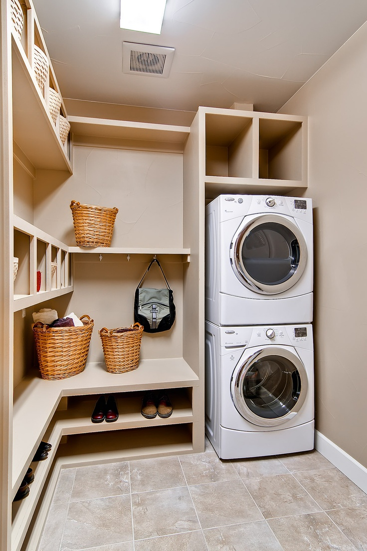 Built-in laundry storage to stay organized
