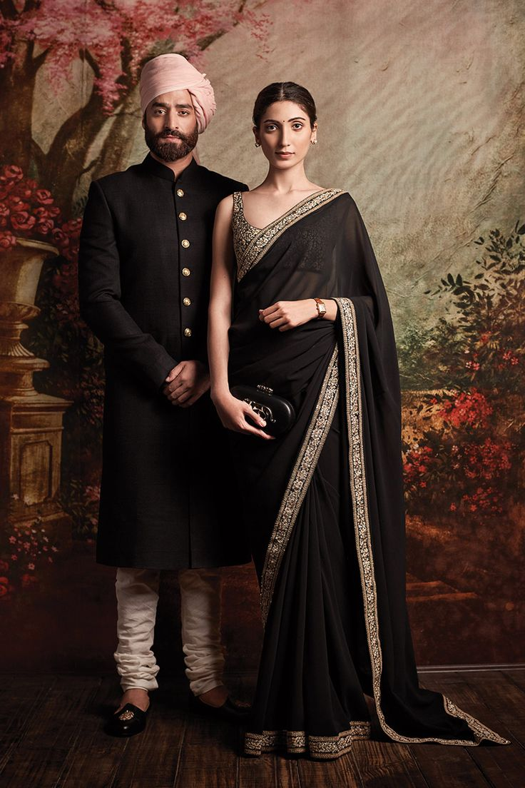 Featuring a black saree based in georgette with embroidered border detailing. It comes with a matching blouse piece with embroidered detailing all over. There will be additional charges for the blouse stitchingFabric: Georgette Care Instructions: Dryclean only.