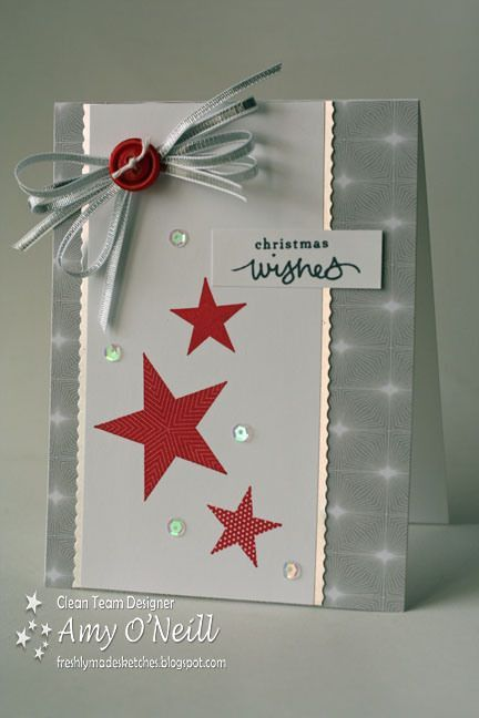 handmade Christmas card by Amy ONeill ...gray and white with red accents ... like the design ... red stars with different prints ... splash of sequins ... red button on silver ribbon bow ... like it!! ... Stampin Up!