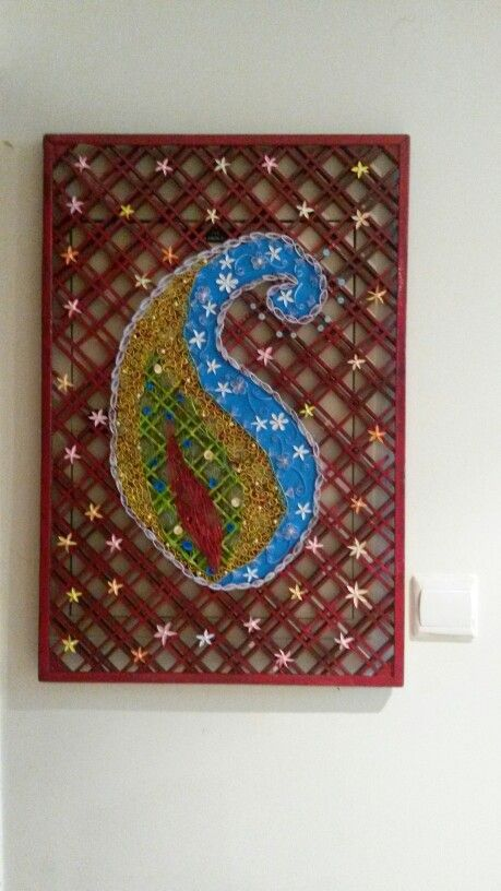 From  door  mat  to  wall  art  through  the  magic  of  quilling.