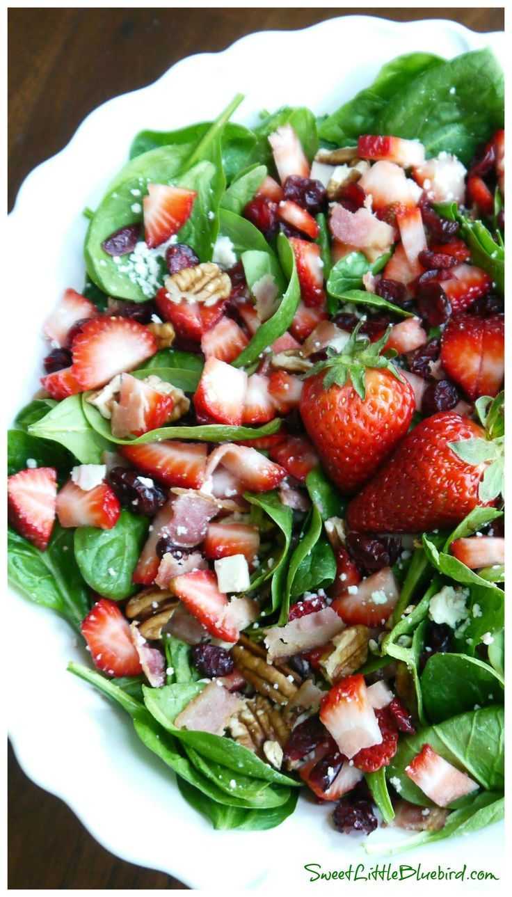 SPINACH STRAWBERRY SALAD -  gorgonzola, bacon, pecans, dried cranberries topped with a wonderful balsamic dressing. Darn delicious!   SweetLittleBluebird.com
