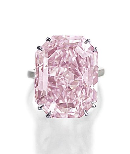 EXTREMELY RARE FANCY INTENSE PURPLE-PINK DIAMOND RING.  The cut-cornered rectangular mixed-cut diamond of fancy intense purple-pink color weighing 28.03 carats, within a simple platinum mounting.