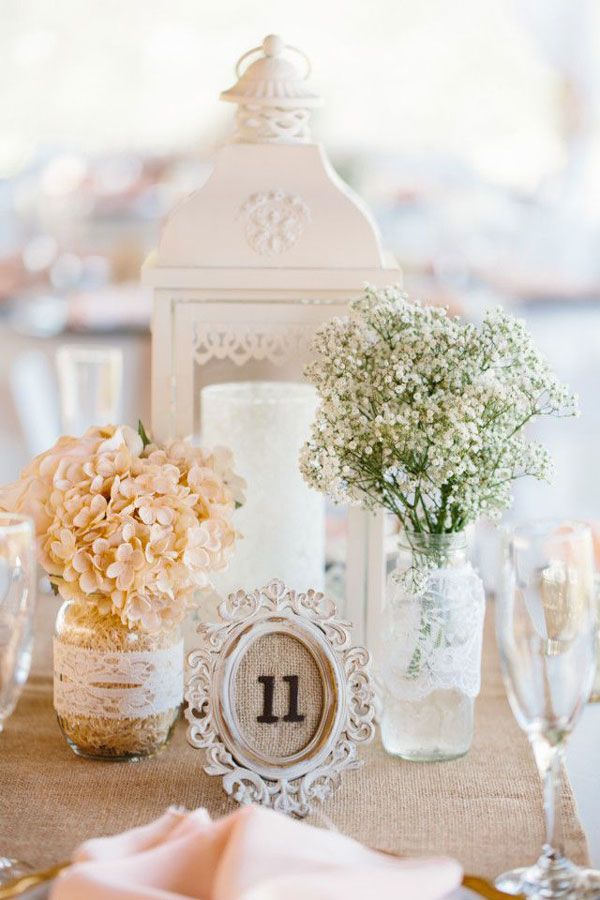 simple vintage centerpiece with baby's breath in lace wrapped jar and burlap framed table number