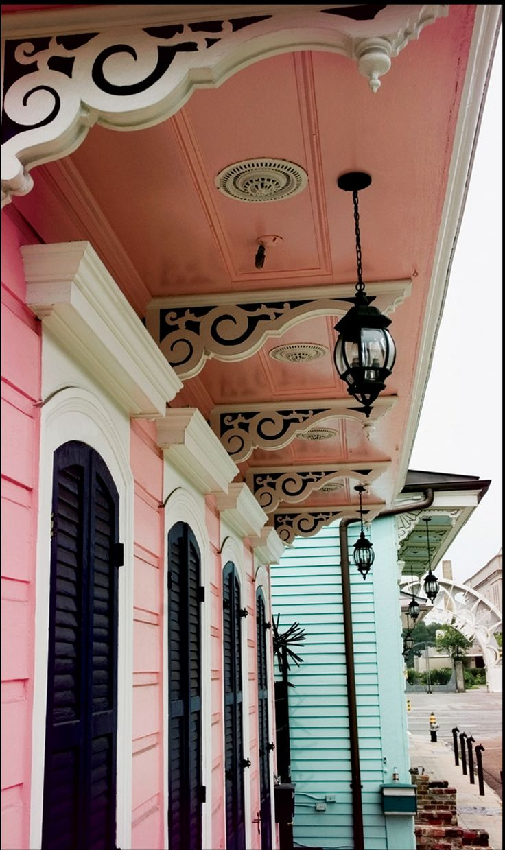 Beautiful Victorian home in NOLA! Victorian shotgun house porch detail - corbels, arched top windows with shutters. Everything from the extravagant decor to the minor details are amazing!