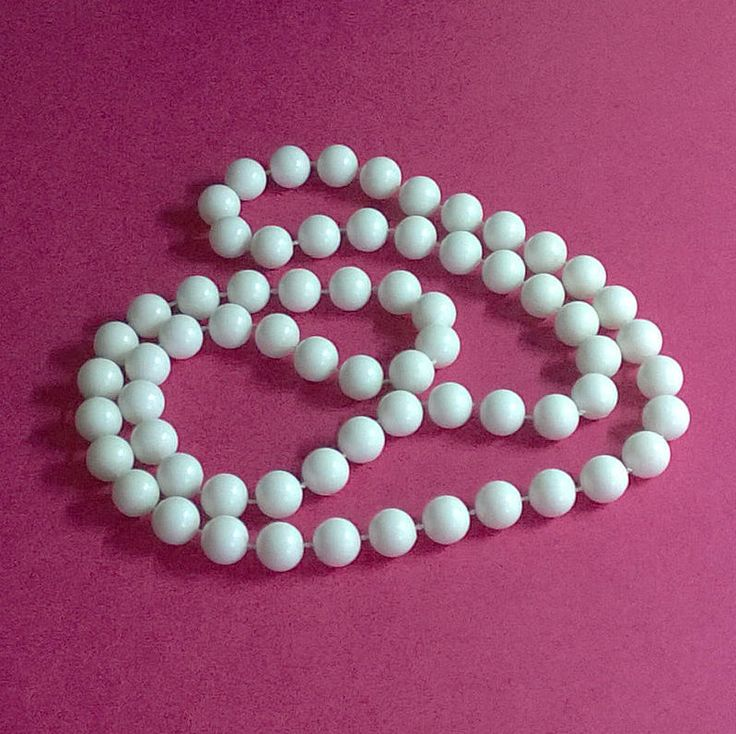 This is a long white plastic retro / vintage style beaded necklace in good used condition. by ThePemburyEmporium on Etsy