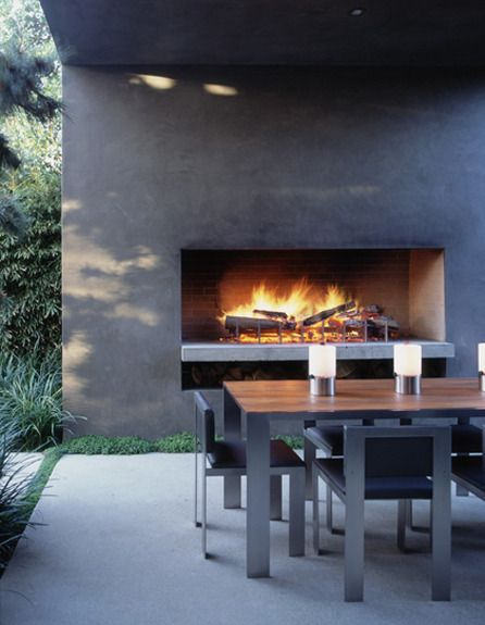 Outdoor fireplace and ding ....very stylish modern Marmol Radziner