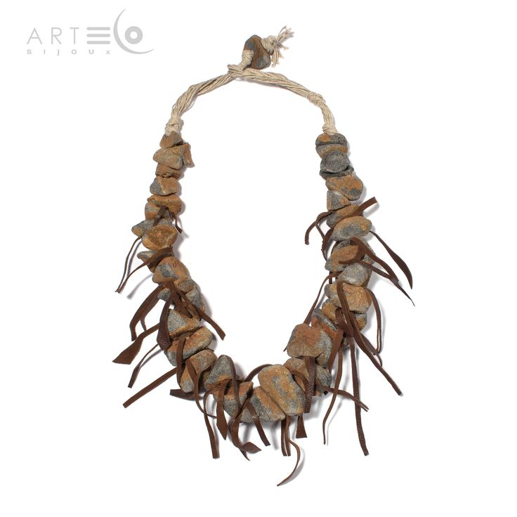 Necklace realized with black/grey oxidized sand, suede elements and rope. The fastening is made with a little oxidized sandy ball. Buy it on  ArtEco's Etsy shop! https://www.etsy.com/listing/189498980/necklace-realized-with-blackgrey