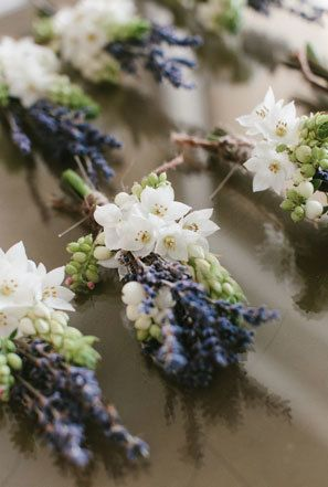 Lavender boutonnieres for French themed wedding. See more French inspired #wedding decor here: http://www.mywedding.com/articles/french-wedding-decor-details/