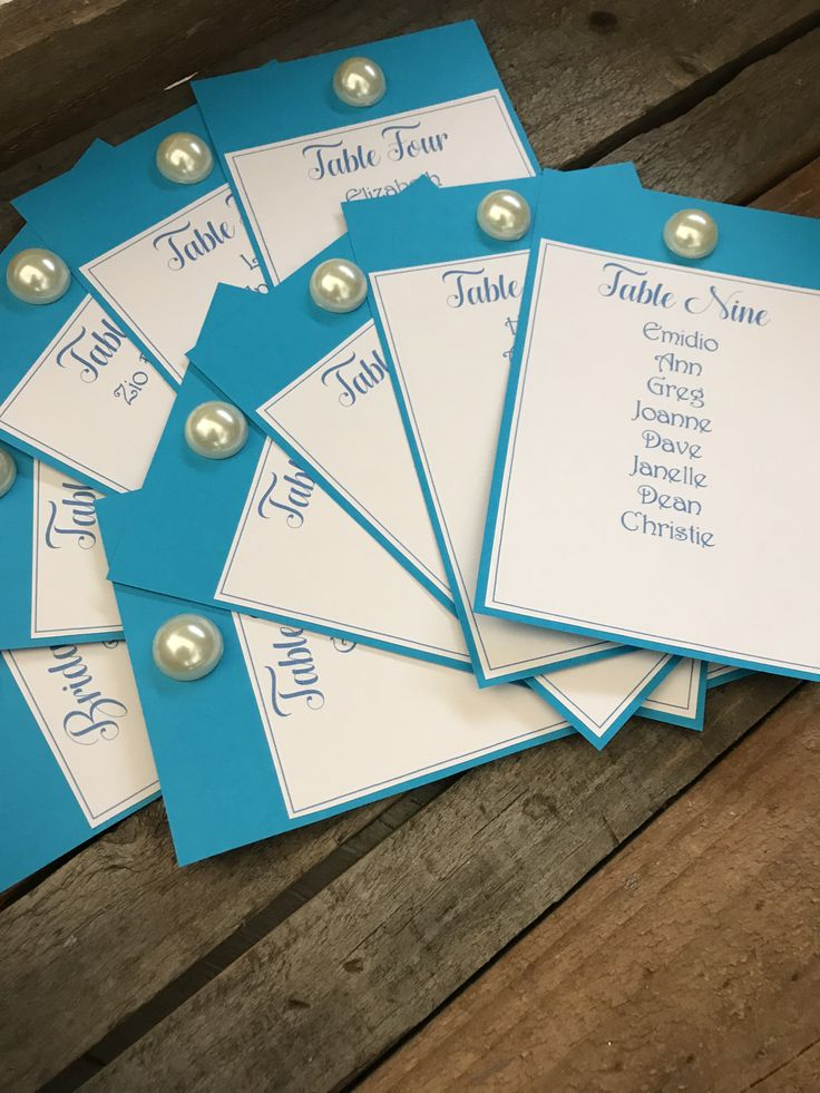 Aqua blue table seating plan cards