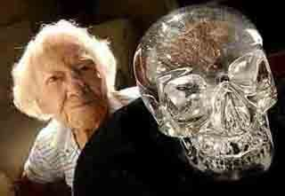 The Mitchell-Hedges crystal skull. This is a famous 10-pound crystal skull, with a hinged jaw, much like a real skull. New Agers believe it is 1 of 13 crystal skulls that ancient knowledge was downloaded into, like a computer. Because stones can hold energy, they believe this is possible. The old lady in the photo was a child when this was found under a Mayan ruin. She was with her dad, an English archeologist. They say the skull has been privately demonstrated to talk and give prophecies.