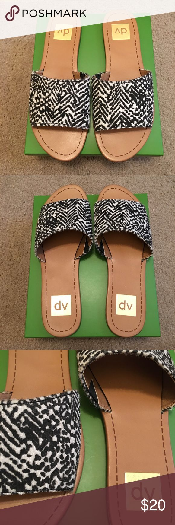 Black and White Print DV Slides Brand new black and white DV slide sandals. Black and white printed faux pony hair. Brand new without tags. Super cute for spring and summer. Size 8. DV by Dolce Vita Shoes Sandals