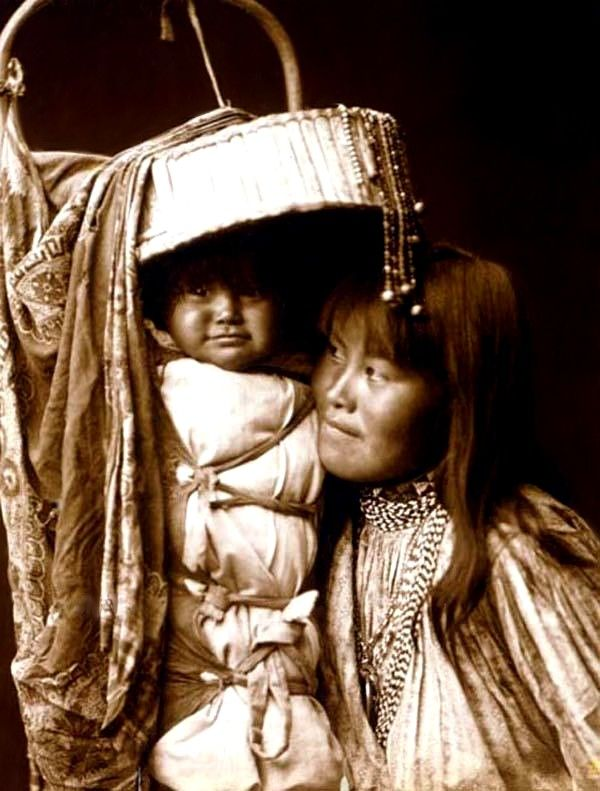 An Apache woman with her baby. Photograph taken in 1903 by Edward S. Curtis.
