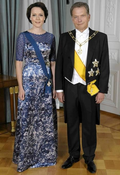 The President of Finland Sauli Niinistö and his wife Jenni Haukio.  Her dress is by IVANAhelsinki _ Thoughtful and beautiful design with our colours blue and white.