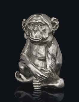 A SILVER TABLE LIGHTER IN THE FORM OF A SMOKING MONKEY MARKED FABERGÉ WITH THE IMPERIAL WARRANT, WITH THE WORKMASTER'S MARK OF JULIUS RAPPOPORT, ST PETERSBURG, 1899-1908, SCRATCHED INVENTORY NUMBER 3165 Realistically modelled, seated and smoking a cigar, the surface chased to simulate fur, the head forming the hinged cover, opening to reveal a lighter fluid compartment with gilt interior, marked on and under base, on ear, and inside neck; also with London import marks for 1911