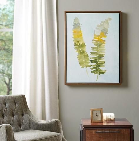 We love this framed nature artwork depicting green and yellow fern leaves. Chic wall art for grey and mustard yellow color schemes.