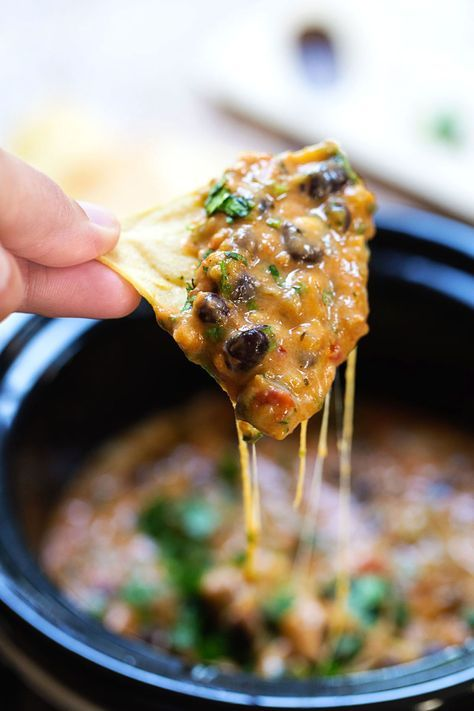 Cheesy Chili Dip - this version of the game-day favorite is MADE FROM SCRATCH! No processed cheese or canned chili - just fresh, flavorful ingredients. 250 calories. | http://pinchofyum.com #chili #dip #gameday #appetizer