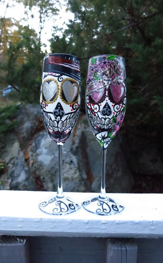 Hand painted red black and gold sugar skull by ArianaVictoriaRose