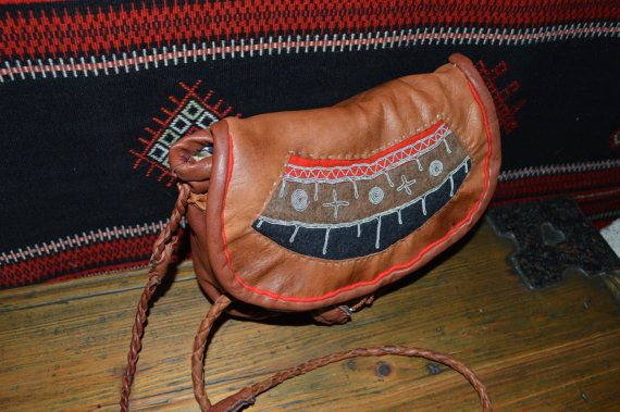 Hand stitched shoulder bag. Reindeer, traditionally willow barked sisna = reindeer leather, wool and tin decoration. Tin wire emproidery is typical decoration for saami people especially in Sweden. This unik bag suits to wear with gakti, the sami folk costume, or in daily life with jeans and so... size: 22 x 19 cm