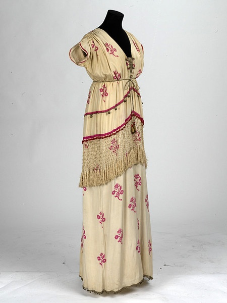 Theatre costume        Date:        1914 (made)      Artist/Maker:        Norman Wilkinson, born 1878 - died 1971 (costume designer)      Materials and Techniques:        Crêpe-de-chine, fringe and beads      Credit Line:        Given by British Theatre Museum Association      Museum number:        S.1355-1984