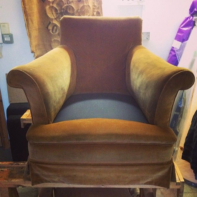 Full traditional restoration completed on the seat of this arm chair. Original covers replaced.