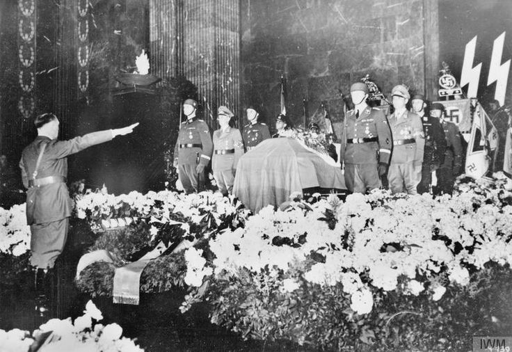 Adolf Hitler gives his last salute at the state funeral of assassinated SS Obergruppenfuhrer Reinhard Heydrich in the Mosaic Chamber of the New Reichschancellery in June 1942.@