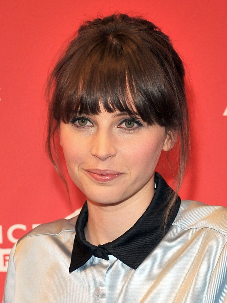 Felicity Jones: Looking for a casual updo? Try Felicity Jones's style from the Breathe In premiere. It left loose tendrils around the face and a touch of height at the crown.