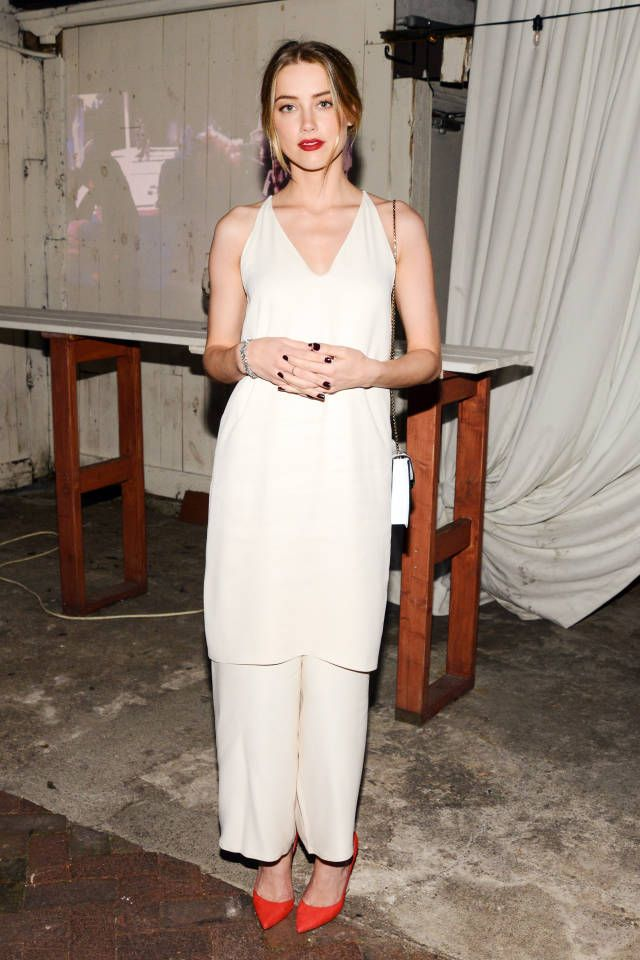 Amber Heard pairs a bohemian and white trousers with a classic red pump. Click here for more style tips.